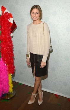 Olivia Palermo in a leather skirt and cable sweater (which is from Old Navy, btw)