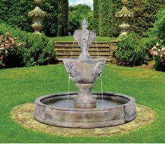 The Medium Two Tier Leonesco in Valencia Pool fountain features two basins, adorned with the faces of regal lions, spitting water from their mouths.