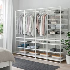 JONAXEL Frame/w bskts/clths rl/shlv uts, cm. It can be difficult to keep things neat and tidy. JONAXEL storage system lets you utilize the spaces you have in smarter ways. Closet Ikea, Ikea Closet Organizer, Closet Redo, Bedroom Closet Design, Closet Designs, Closet Space, Closet Organization, Organization Ideas, Ikea Closet System