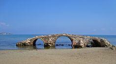 Argassi Bridge, stone bridge built in 1805 on a seaside road (now eroded by the sea) in Zakynthos, Greece