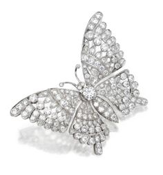WHITE GOLD AND DIAMOND BROOCH. The brooch designed as a butterfly set with round diamonds weighing approximately 4.25 carats