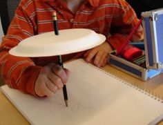 Blind contour drawing is a fun way to see how accurately we can draw when we observe something very carefully, by looking at it and not looking away. - Using a paper plate is a great way to accomplish this.