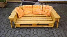 It is a wooden pallet handmade lounge chair which is placed outdoor and its planks are painted with yellow color which his clearly shown in the picture. You can sit on this easily and can take rest and as well as you can take sun bath and can enjoy the cool whether of the day. It is very simple and unique pallet ideas for you which you can take it from here if you like.