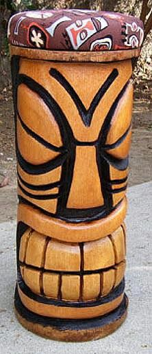Slanted eyes and huge square uneven grill (teeth if your oldschool) tiki stool