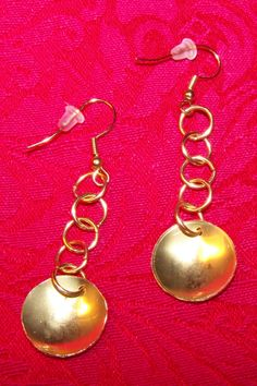 Brass ear rings made for granddaughter.  Started with sheet and wire, Then a little bending, cutting, hammering, etc.