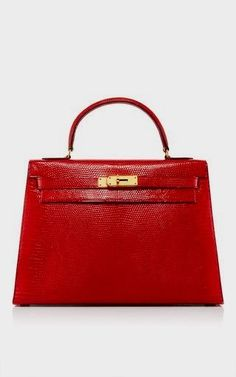 3699459dd This **Hermes** Sellier Kelly bag curated by **Heritage Auctions Special  Collections** is rendered in Salvator Lizard and features gold hardware and  a ...