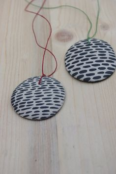 ceramic pendant = hand-painted white clay + coloured linen cord