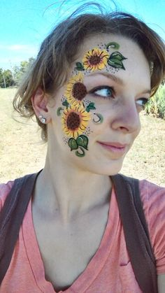 Sunflower design by Abby's Face Paint-N-Glitter