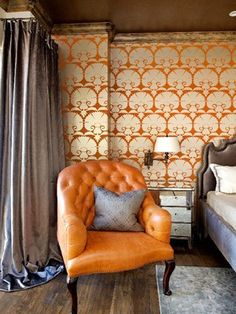 Orange and gray bedroom. Beautiful orange leather chair, wallpaper, curtains, bed. Everything. It's perfect.