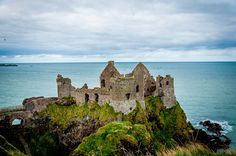 Ruins of the Dunluce Castle on the Antrim Coast Road in Northern Ireland.