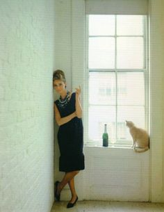 >>> a more candid shot of Audrey with cat and alcohol, (Breakfast at Tiffany's)