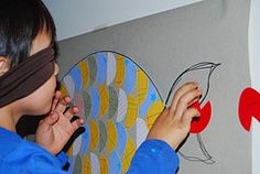 DIY Pin the tail on the fish For Pin the Tail on the Fish (pictured), I used an old cardboard as the base, drew a picture of a fish with a Sharpie, then pasted half circles as scales. The half circles were made by using a circle punch with coloured scrap papers, then cutting them in half. For the tails, I punched circles in red cardstock, then cut a small bit, to make them look like tails. I numbered all the 'tails' and put tape at the back. I also used an elastic headband as blindfold.