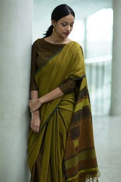 This Khaki green saree is soft and easy to drape. The saree is inspired by geometric shape and have intorduce shapes in the saree to give a modern and an artist Indian Attire, Indian Wear, Saree Styles, Blouse Styles, Saree Blouse Designs, Blouse Patterns, Indian Dresses, Indian Outfits, Simple Sarees