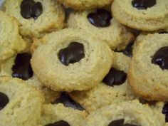 These pretty low carb peanut butter cookies are easy to make. A basic gluten free almond flour base dough is scooped onto the cookie sheet then pressed down with a thumb or spoon. The indent made is then filled with sugar free chocolate.
