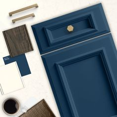 Navy Blue painted Dura Supreme cabinetry. Shown in St. Augustine door style in Sherwin Williams (SW 9177) Salty Dog paint. Featuring Bianco Drift from Caesarstone countertop. #moodboardmadness #SWColorLove