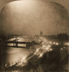 London England 1902  'Overlooking the Thames at Night'  The view along the Victoria Embankment features Big Ben in the background; the bridges are Hungerford, Westminster and Lambeth Bridge in the distance. The image that was originally part of a stereograph.