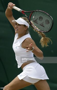 Anna Kournikova of Russia in action with her playing partner Chanda Rubin of the USA during their doubles match against Janet Lee of Taipei and Wynne Prakusya of Indonesia at the All England Tennis Championships at the All England Lawn Tennis Club, Wimbledon, England, on July 2, 2002.