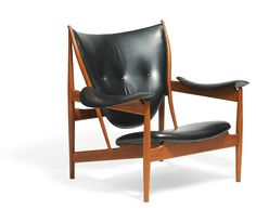 "Finn Juhl // Niels Vodder // ""Chieftain Chair"". A teak easy chair. Seat…"