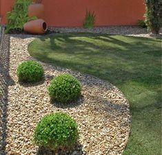 Le gravier décoratif, un matériau naturel et trendy en aménagement de jardin moderne