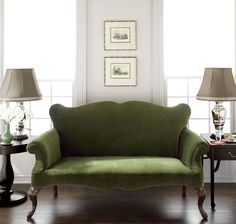 Green couch with dark floor and white walls ... Maybe do black and white prints in chome frames