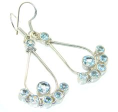 $51.26 Very Light Swiss Blue Topaz Sterling Silver earrings at www.SilverRushStyle.com #earrings #handmade #jewelry #silver #topaz
