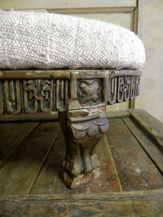 Antique hand-carved footstool re-upholstered in a rustic tweed fabric