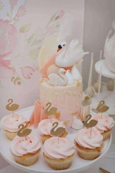 Loving the toppers on these pretty pink cupcakes at this Swan Birthday Party! See more party ideas at CatchMyParty.com