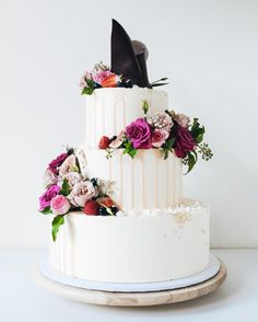 Asymmetric floral crescent wedding cake, florals supplied by @blooms_by_elle - see @cakesbycliff Instagram