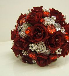 Red brooch bouquet.I want this! It completes my vintage fifties wedding:).
