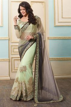 Buy Sky Blue Net-Lycra Saree with Net Blouse at best prices Online from Indian shopping store.
