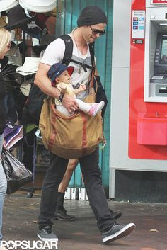 Chris Hemsworth and Elsa Pataky Stroll in Sydney With Baby India: Chris Hemsworth held his baby daughter, India Hemsworth.