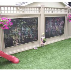 Giant chalkboards on the fence - love it! Hang a tin bucket for chalk ; ) but first - I want that cute fence!!