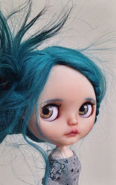 This is Selkie. Selkie was born in the ocean as a seal but shed her skin and is now living rest of her days on earth as a human child. She is a Miss Sally Rice with a gorgeous teal reroot by Piparr…