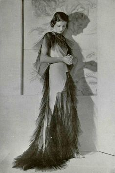 "Callot Soeurs. ""Le Piege"" Dress in matt white satin crepe, trimmed with black sized tulle. L'officiel de la mode 1935."