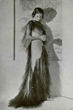 """Callot Soeurs. """"Le Piege"""" Dress in matt white satin crepe, trimmed with black sized tulle. L'officiel de la mode 1935."""