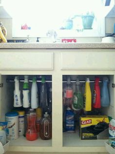 genius!! Tension rod for under the sink organization!