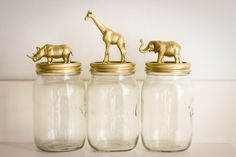 DIY decorated mason jar. Buy cheap plastic animals from the dollar store, whip out the hot glue gun, and spray paint them gold!