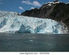 The Holgate Glacier in Alaska's Kenai Fjords National Park pushes out into the ocean. ©Photo copyright by Marty Nelson. Photographer website: http://www.bigstockphoto.com/search/?start=750&contributor=Marty+Nelson+Photo+Art&safesearch=n