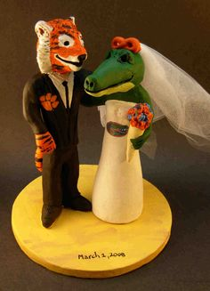 Football Fans Cake Topper, Custom Made College Football Mascot Wedding Cake Topper    College Football Mascot Wedding Cake Topper, Tiger Bride Wedding Cake Topper,  Customized football wedding cake toppers, these were commissioned for marriages and wedding ceremonies involving a bride and groom who love football    $235 #magicmud 1 800 231 9814 www.magicmud.com