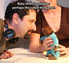Take a quick break from geek stuff and LOOK AT THIS BABY SLOTH IN PAJAMAS.