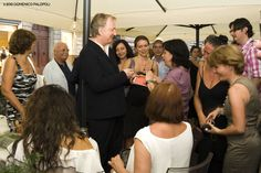 """Alan signing autographs with Rima nearby. July 15, 2010 - Alan Rickman at the screening of """"Bottle Shock"""" in Florence, Italy."""