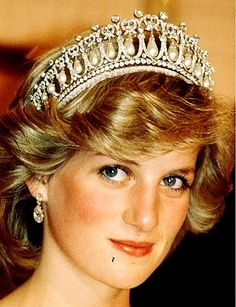 This crown made of pearls that hang from 19 diamond arches capped with lover's knots was composed with existing jewels that Queen Mary had in her collection originated in 1913/1914 Queen Mary modeled it from a tiara owned by her grandmother. After Mary died in 1953, the tiara was passed to Queen Elizabeth II who wore it regularly throughout the 1950s. Queen Elizabeth gave the tiara to Princess Diana as a wedding gift which Diana to be quite heavy therefore opted to wear the Spencer's Tiara.