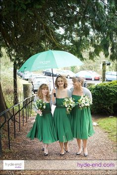 Why not accessorise your bridesmaids' dresses with matching colour umbrellas?