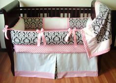 Addison Black Baby Bedding   Included in this custom crib set is the bumper, blanket, and crib skirt.  There are lots of details in this modern set including soft pink and white minky, pink grosgrain ties, black and white designer cotton, white pique, and pink pique detail piping and trim.