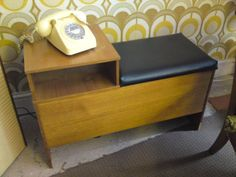 "The ""Telephone Table"" - yes, every home had one of these in the hall, where you would sit for the couple of seconds that you were allowed to use the phone, in the freezing cold in the hallway. It had a convenient section underneath to store your phone directory."