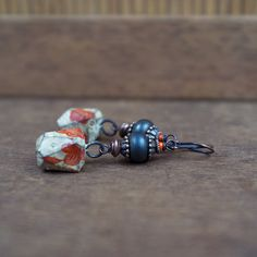 rustic boho earrings • artisan Lampwork glass bead • ceramic pendant • red flower decals • tribal earrings • raw copper • ceramic earrings