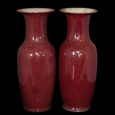 Lot #202: Sang De Beouf Vases DESCRIPTION: A pair a chinese porcelain vases painted in a red mahogany color on the outside and finished with a glaze. In excellent condition considering age.  CIRCA: Late 19th Century ORIGIN: China DIMENSIONS: 8 3/4″ W x 24″ H