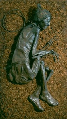 Full body of Tollund Man. It appears to be a ritual hanging, with the mummified body found in Denmark in a peat bog.