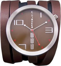 """""""The Longest Watch in the World!""""    The 'John' watch from 666 Barcelona has an extra long leather strap which wraps around the wrist countless times.  This coupled with the oversized face and extra long hands create a timepiece for the female with a unique taste.   £100.00"""