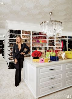 Khloé in her vast master closet; the chandelier is by RH, and the ceiling is lined in a Schumacher wallpaper. wallpaper Khloé and Kourtney Kardashian Realize Their Dream Homes in California Master Closet, Closet Bedroom, Walk In Closet, Master Bedroom, Master Bath, Huge Closet, Closet Space, Master Suite, Celebrity Closets